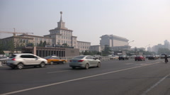 Traffic drives past the military museum in Beijing, China Stock Footage