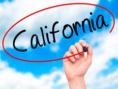 Man Hand writing California with black marker on visual screen - stock photo