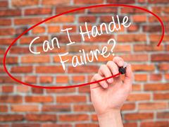 Man Hand writing Can I Handle Failure? with black marker on visual screen - stock photo
