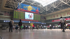 China transportation, train passengers, Beijing railway station, schedule board Stock Footage
