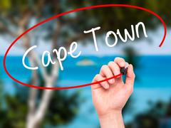 Man Hand writing Cape Town with black marker on visual screen Stock Photos