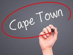 Man Hand writing Cape Town with black marker on visual screen - stock photo
