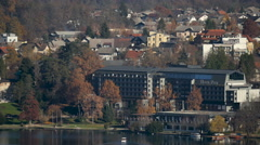 View of Hotel Park and other buildings on the shore of Bled lake, Bled - stock footage