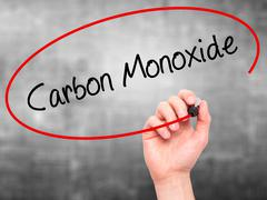 Man Hand writing Carbon Monoxide  with black marker on visual screen - stock photo