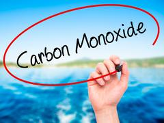 Man Hand writing Carbon Monoxide  with black marker on visual screen Stock Photos