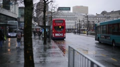 Establishing shot of Manchester: double deckers in the rain, England, Europe Stock Footage