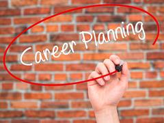 Man Hand writing Career Planning with black marker on visual screen Stock Photos