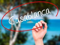 Man Hand writing Casablanca with black marker on visual screen - stock photo
