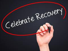 Man Hand writing Celebrate Recovery with black marker on visual screen - stock photo