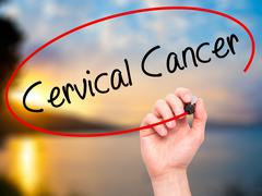 Man Hand writing Cervical Cancer with black marker on visual screen - stock photo