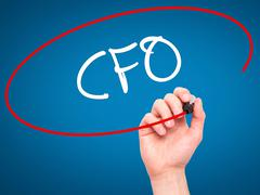 Man Hand writing CFO (Chief Financial Officer) with black marker on visual sc - stock photo