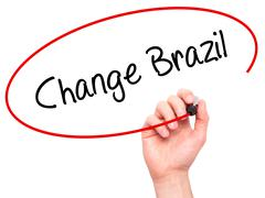 Man Hand writing Change Brazil  with black marker on visual screen - stock photo