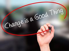 Man Hand writing Change is a Good Thing with black marker on visual screen - stock photo