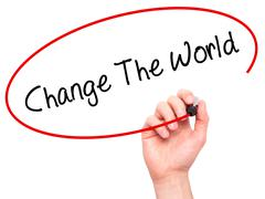 Man Hand writing Change The World with black marker on visual screen - stock photo