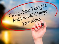 Man Hand writing Change Your Thoughts And You Will Change Your World with bla - stock photo