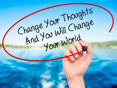 Man Hand writing Change Your Thoughts And You Will Change Your World with bla Stock Photos
