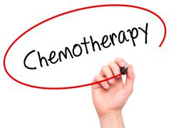 Man Hand writing Chemotherapy with black marker on visual screen - stock photo