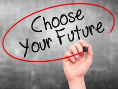 Man Hand writing Choose your Future with black marker on visual screen Stock Photos