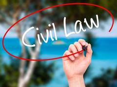 Man Hand writing Civil Law with black marker on visual screen - stock photo