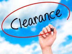 Man Hand writing Clearance  with black marker on visual screen Stock Photos