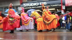 Boys wearing horses costumes marching on lunar year parade Stock Footage