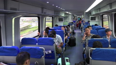 Traveling on the Beijing Airport Express train Stock Footage
