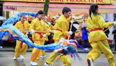 Children wearing traditional Chinese costumes dancing on street Stock Footage