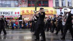 Military orchestra performing on parade Stock Footage