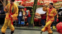 Young Chinese males performing dragon dance Stock Footage