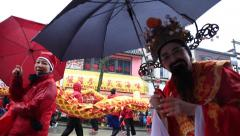 Male wearing Chinese Emperor costume waving at camera Stock Footage
