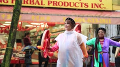 Chinese female dancers performing at lunar parade Stock Footage