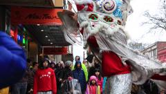 Traditional lunar lion dance, retail district, Vancouver Stock Footage