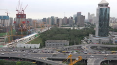 Beijing construction site, scaffolding, skyline, business district, China - stock footage