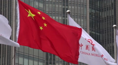 World Trade Center flag next to Chinese national flag in Beijing Stock Footage