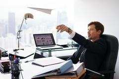 Daydreaming Successful Man Office Worker Throwing Paper Airplane Kuvituskuvat