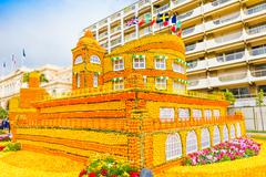 Building made of lemons and oranges in the famous carnival of Menton, France. - stock photo