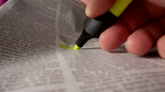 Yellow marking an article Stock Footage