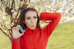 Surprised  Woman with Inhaler  in Spring Blooming Decor Stock Photos