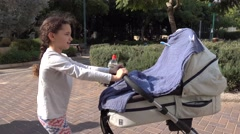 Little Girl walking stroller Stock Footage