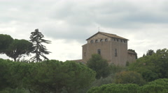 View of trees and an old building on a cloudy day in Rome Stock Footage