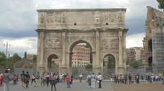 People walking and taking pictures in front of Arch of Constantine in Rome Stock Footage