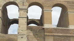 Arches and columns of Colosseum amphitheatre in Rome - stock footage