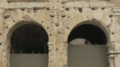 Tilt view of arches of Colosseum in Rome - stock footage