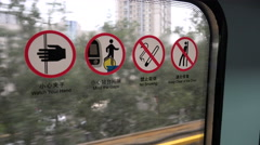 Signs explain how to behave inside a subway carriage in Beijing Stock Footage