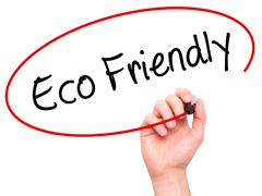 Man Hand writing Eco Friendly with black marker on visual screen - stock photo