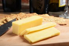 White cheddar cheese with stone ground whole wheat crackers - stock photo