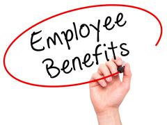 Man Hand writing Employee Benefits with black marker on visual screen - stock photo