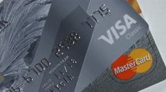 Macro close up dolly shot of  two major credit cards Visa and MasterCard over Stock Footage