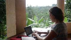 Young woman blogging from tropics Stock Footage