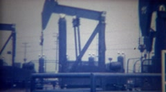 1956: Oil rig pump jacks sucking black gold crude underground. Stock Footage